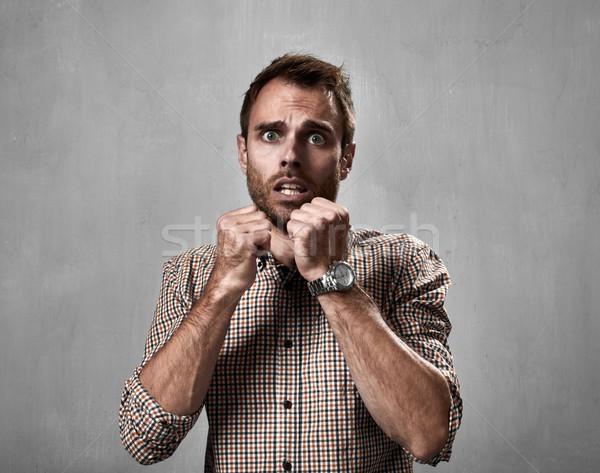 Shocked man face. Stock photo © Kurhan