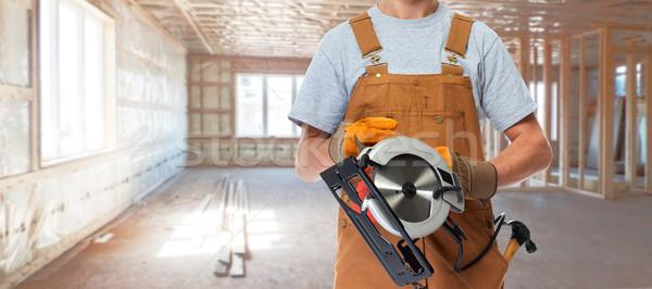 Trabalhador mãos elétrico serra profissional Foto stock © Kurhan