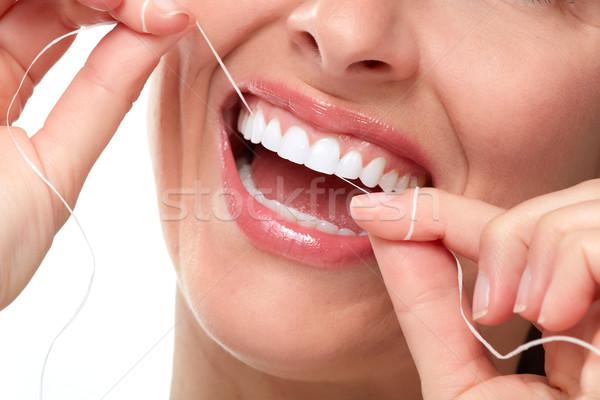 woman smile with tooth floss Stock photo © Kurhan