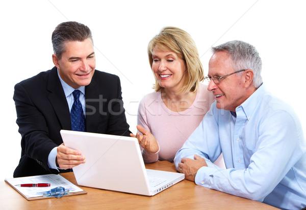 Foto stock: Casal · de · idosos · financeiro · profissional · isolado · branco