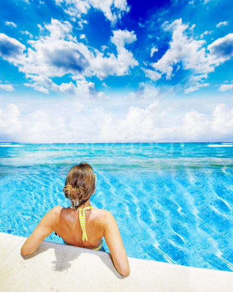 Woman in swimming pool at caribbean resort. Stock photo © Kurhan