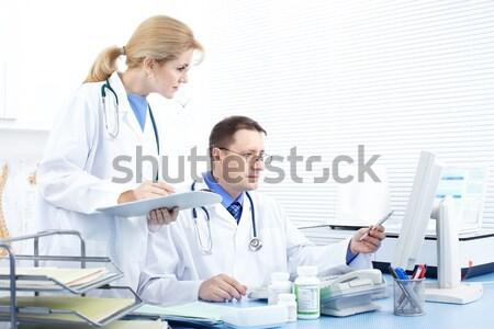 doctors and woman patient Stock photo © Kurhan