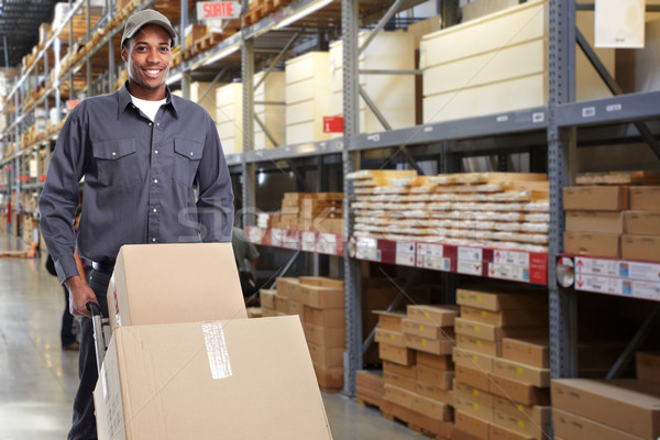African-american delivery postman. Stock photo © Kurhan