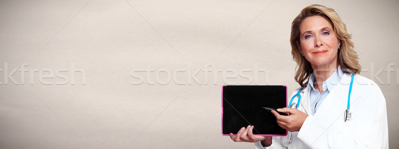 Doctor pharmacist with tablet computer. Stock photo © Kurhan