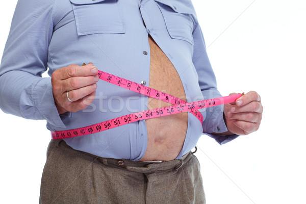 Grubas duży żołądka zdrowia Zdjęcia stock © Kurhan