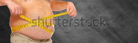 женщину большой брюки живот черный Сток-фото © Kurhan