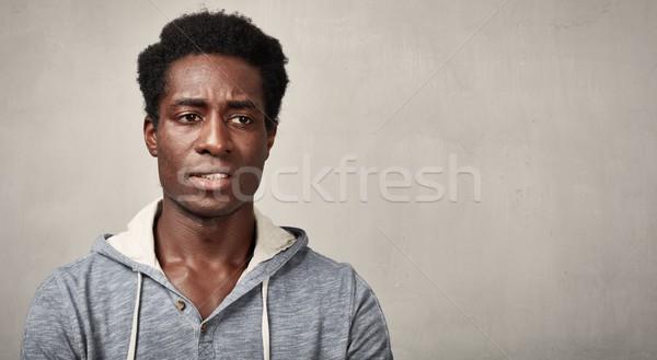Thinking black man Stock photo © Kurhan