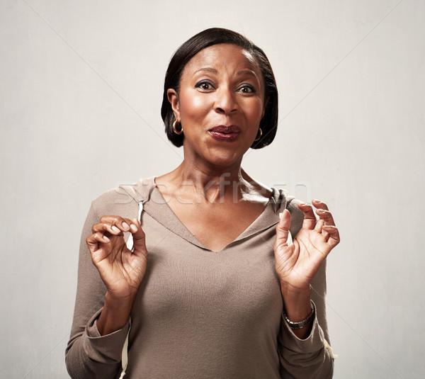 Happy surprised black woman Stock photo © Kurhan