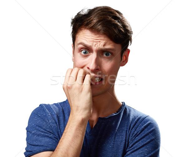 Niespokojny człowiek twarz nerwowy młody człowiek ludzi Zdjęcia stock © Kurhan
