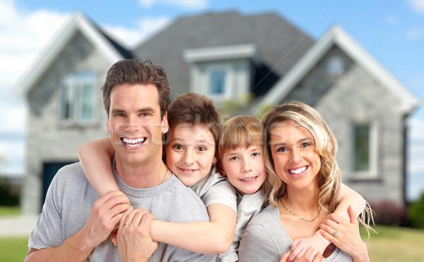 Happy family near new home. Stock photo © Kurhan