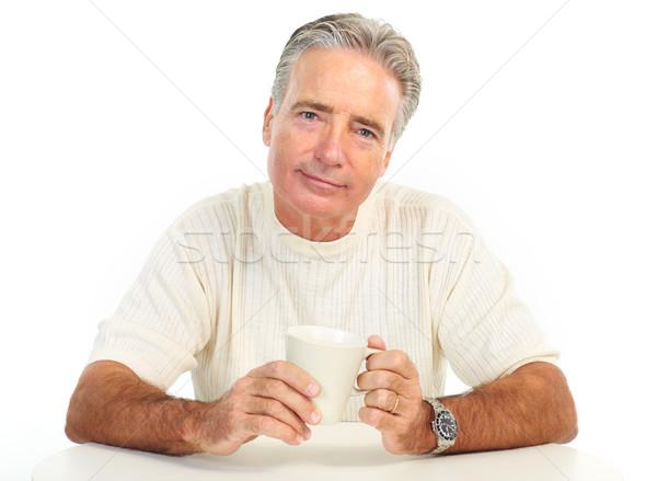 Ancianos hombre sonriendo taza aislado blanco Foto stock © Kurhan
