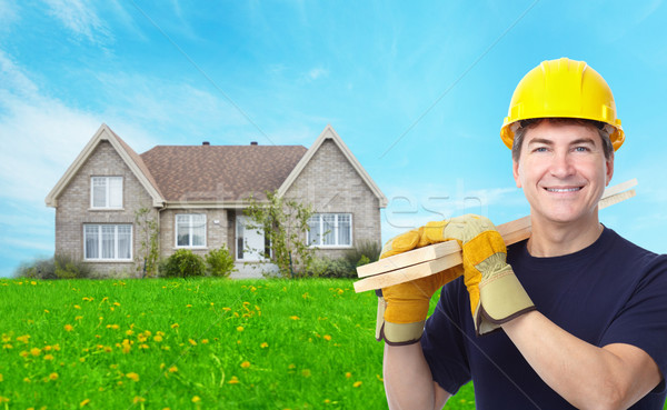 Handyman near new house. Stock photo © Kurhan