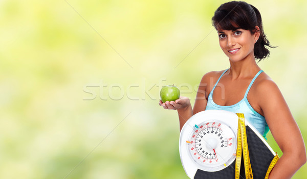 Young asian woman with apple and scales. Stock photo © Kurhan