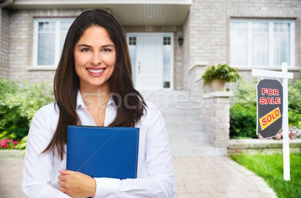Real Estate agent woman near new house. Stock photo © Kurhan