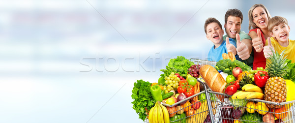 Happy family with grocery shopping cart. Stock photo © Kurhan