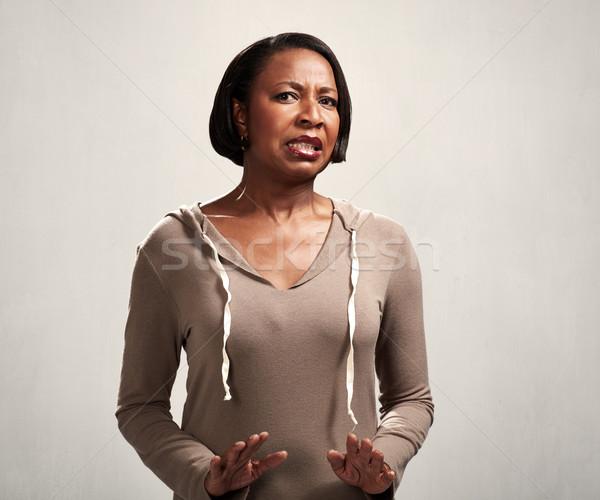 unfriendly black woman Stock photo © Kurhan