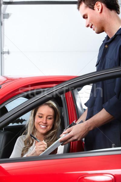 Auto mechanic and a client woman. Stock photo © Kurhan