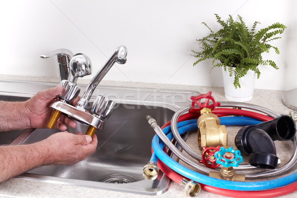 Plumber with a water tap. Stock photo © Kurhan