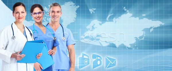 Orvosok csapat egészségügy szalag kék nő Stock fotó © Kurhan