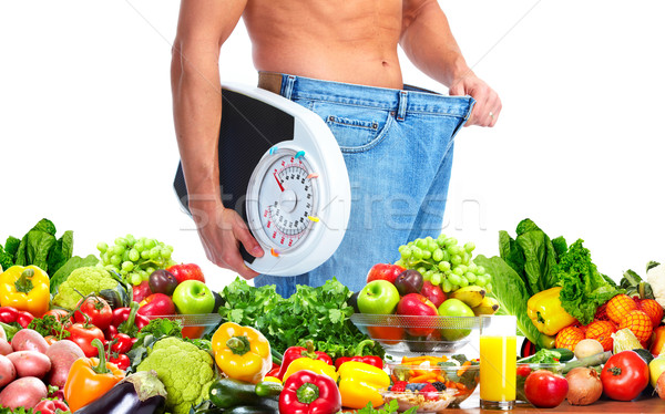 Man with scales and fruits Stock photo © Kurhan