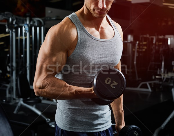 Dumbbell biceps workout Stock photo © Kurhan