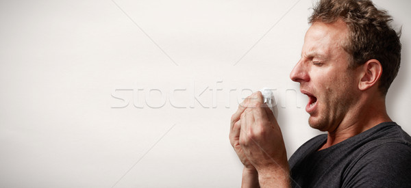 sneezing man with cold Stock photo © Kurhan