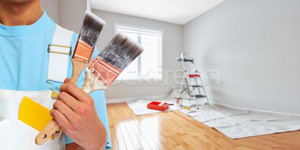 Painter hand with painting brush Stock photo © Kurhan