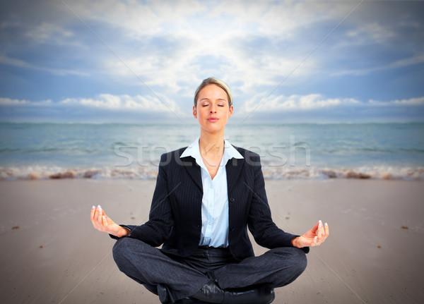 Mulher de negócios ioga praia férias mulher água Foto stock © Kurhan