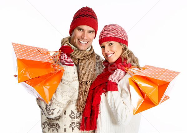 счастливым торговых пару мешки изолированный белый Сток-фото © Kurhan