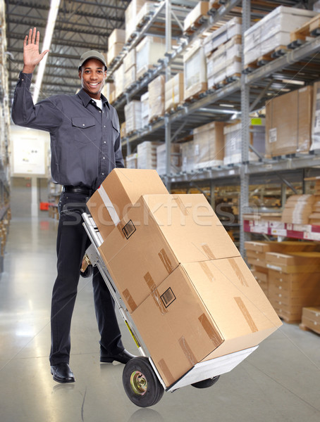African-American postmanwith parcels. Stock photo © Kurhan