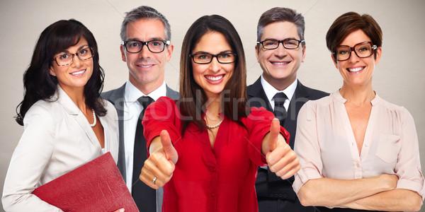 Group of business people wearing eyeglasses. Stock photo © Kurhan