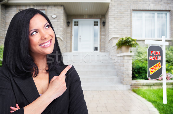 Asian Real Estate agent woman near new house. Stock photo © Kurhan