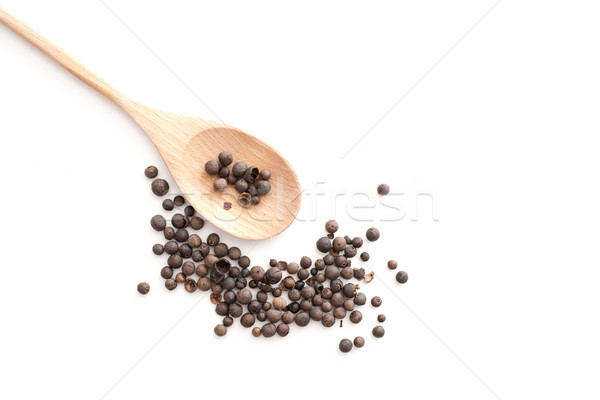 Stock photo: Allspice on wooden spoon isolated on white background