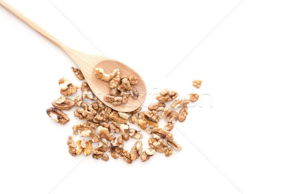 Peeled dried pieses of walnuts on wooden spoon isolated on white Stock photo © kurkalukas
