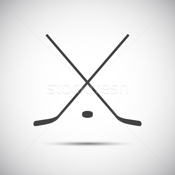 Simple crossed hockey stick with puck, vector icon Stock photo © kurkalukas