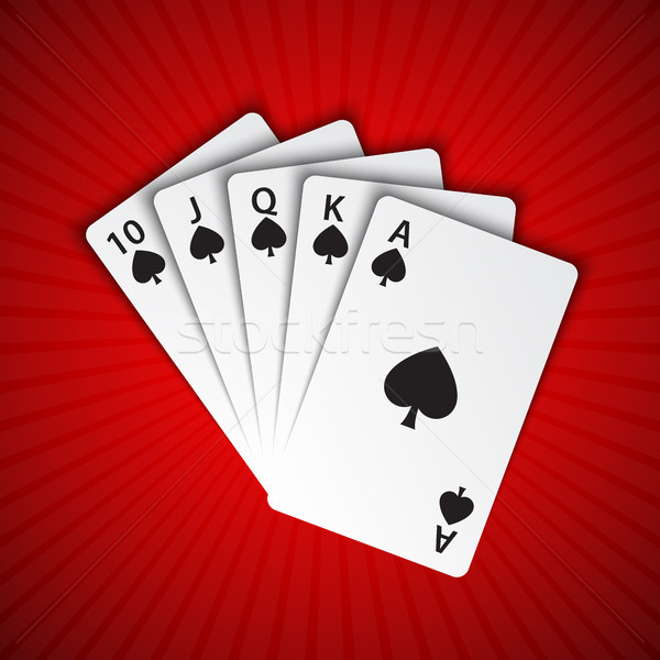 A royal flush of spades on red background, winning hands of poker cards, casino playing cards Stock photo © kurkalukas