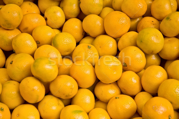 Heap Of Ripe Mandalinas At A Street Market In Istanbul, Turkey. Stock photo © Kuzeytac