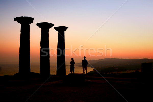 Two Tourists Watching The Sunset At The Athena Temple Stock photo © Kuzeytac