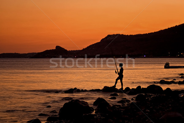 Eenzaam visser zonsondergang jongen vissen alleen Stockfoto © Kuzeytac