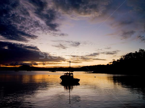 Halászhajók sziluett víz felhők természet utazás Stock fotó © kwest