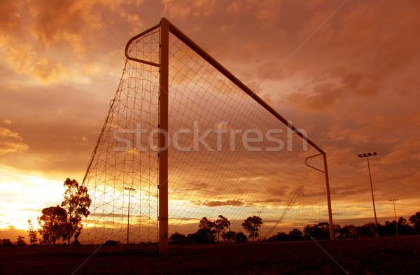 Fútbol puesta de sol naranja objetivo hierba deporte Foto stock © kwest