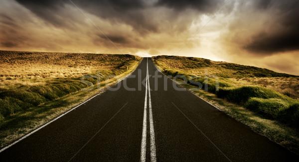 Weg lang rechtdoor zonsondergang hemel wolken Stockfoto © kwest