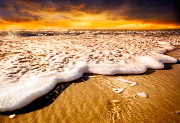 Gün batımı kıyı dalgalar plaj su Stok fotoğraf © kwest