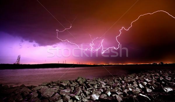 Villám kövek víz felhők tenger óceán Stock fotó © kwest