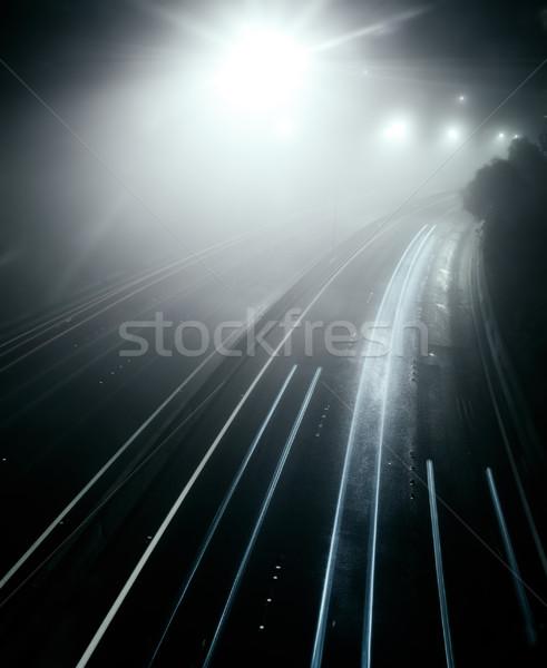 Mistig snelweg nacht auto weg stad Stockfoto © kwest