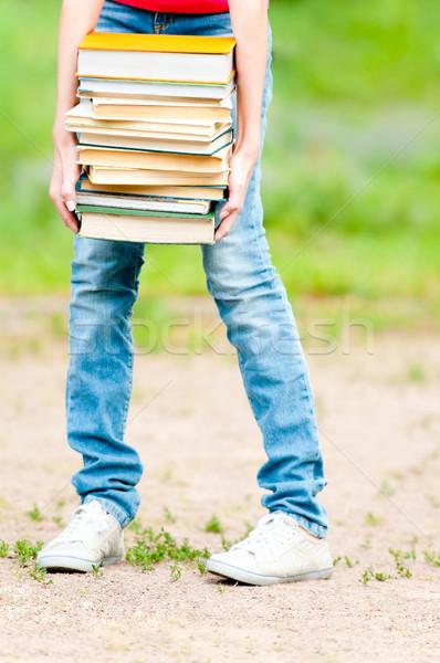 Diák lány tart nagy köteg nehéz Stock fotó © kyolshin