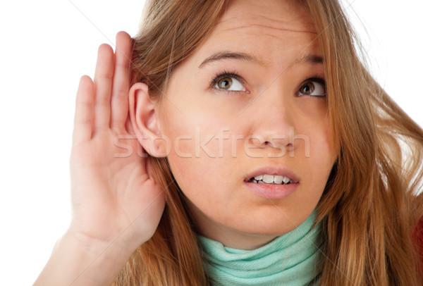Tinilány hallgat gyönyörű kéz fül valami Stock fotó © kyolshin