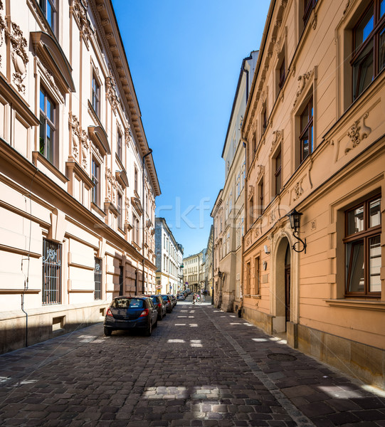 Narrow empty street with parked cars in Krakow, Poland. Stock photo © kyolshin