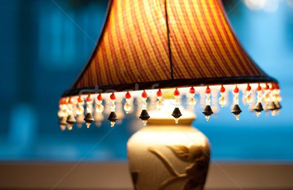 Classic lamp with dim light near window. Stock photo © kyolshin