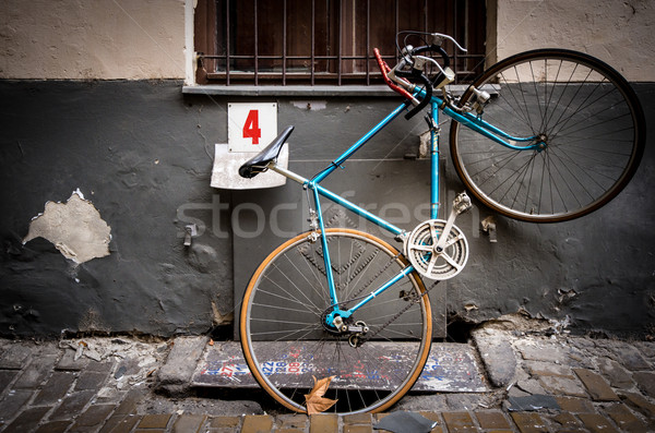 Old bicycle parked in street of Budapest, Europe. Stock photo © kyolshin